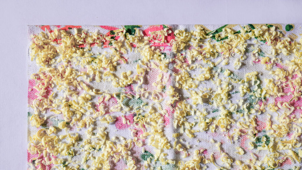 Spread grated wax on the fabric
